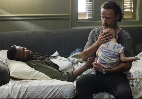 In a powerfully emotional, though understated scene Bob imparts his final sermon of positivity, one not grounded in Hallmark-birthed warm and fuzzies but gleaned from life in the apocalypse where you always choose who you are and who you will remain (image (c) Photo by Gene Page/AMC via official AMC TWD page)